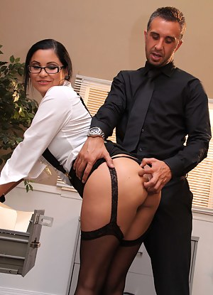 This brunette hottie is just walking around the office dressed like a slut, everyone notices but only one guy decides to act on his urges!
