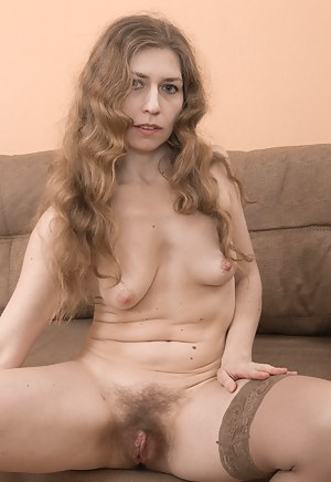 Elza is wearing a new red dress and showing her 37 year-old body off with class. She takes it off and poses with her hairy pits and hairy pussy showing. She relaxes on her couch posing naked and is hot.