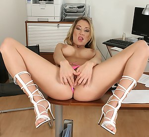 Claudia gets caught playing with her mature pussy at the office