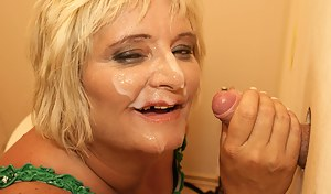Mature blonde slut sucking and fucking on a toilet