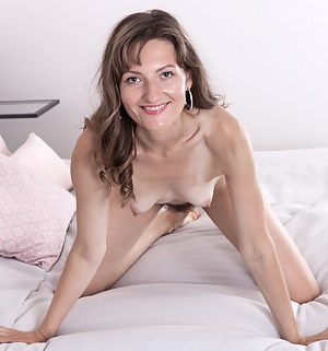 Lulu is enjoying her black lingerie and modeling away her sexy figure. She strips nude and lays back on her bed. Her 5'8