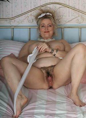 Blonde mature slut showing her luscious body