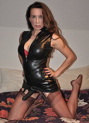 Strapon Jane slips in to a sultry pair of nylon stockings and a bit of leather to go with her big black strapon,  before her virgins come over for a fuck