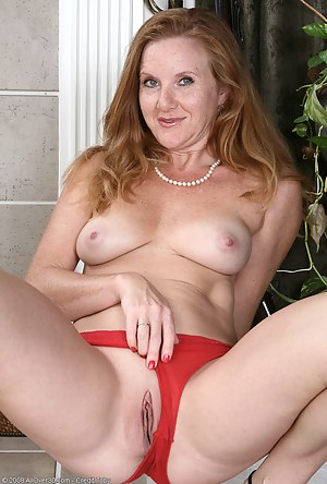 Pushing her red panties to the side provides a great pussy peek