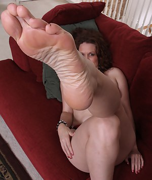 Roxanne Clemmens loves to rub and play with her feet to tease us