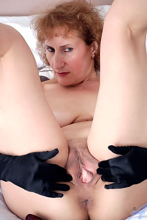 Busty redhead cougar spreads her luscious wet cunt