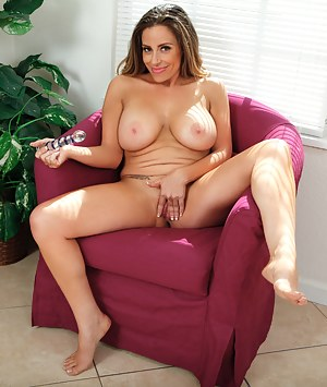 Sexy housewife teases her mature pussy with long glass dildo