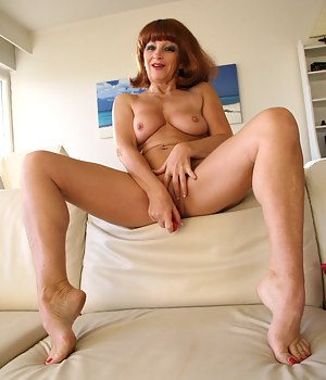 Naughty red housewife playing with her pussy