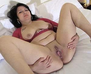 Kinky mama getting herself wet with her toy