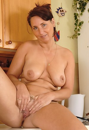 Sexy MILF Demi undresses and spreads her 45 year old legs here