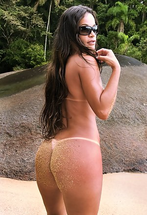 Slutty brunette having nice ass is ready to fuck all day long. She is enjoying passionate penetration and sensual oral sex on the beach.