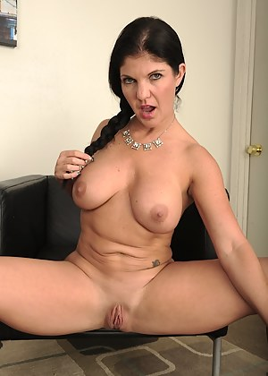 Sexy big breasted cougar Coralyn Jewel strips naked.