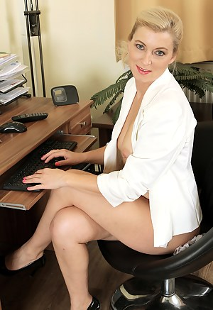 Watch as 39 year old Michelle H strips and spreads at her desk