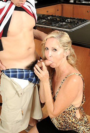 Annabelle slides her 55 year old pussy over some young hard cock