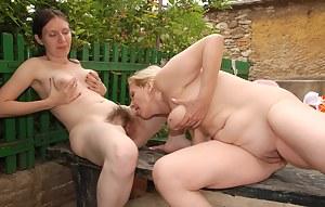 Mature lesbian doing a hairy teen