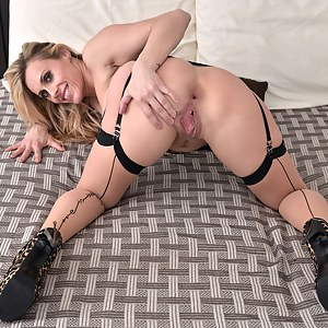 Mature bombshell gets naughty in bed playing with her wet shaved fuckhole