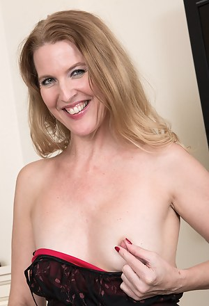 Sultry Lacy F looks amazing in her red dress as she shows off those long sexy legs
