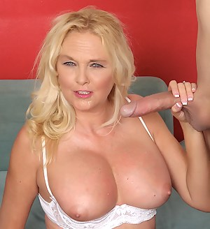 Mature woman shows her assets before sucking a stiff dick so good