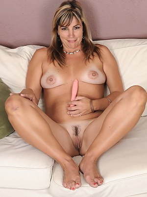 Horny 49 year old Fire Fly slips a sleek pink dildo into her hot pussy