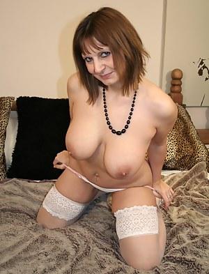 Horny English mature slut playing alone