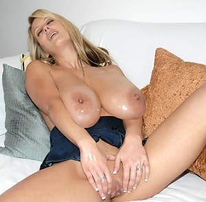 Lovely model having white hair is showing her big boobs and enjoying passionate solo. She is torturing her juicy vagina with huge dildo.