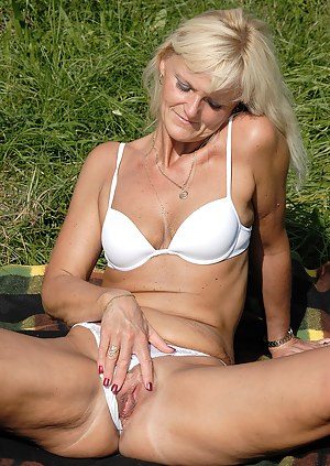 43 year old Jenny F strips and shows off her tight ass in the grass