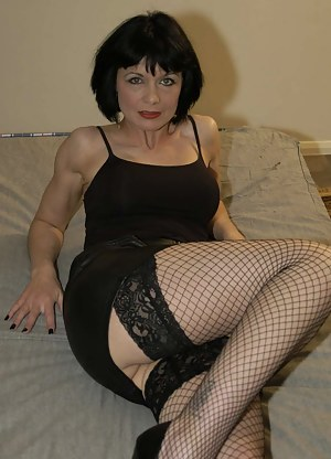 British MILF Barbie Stoker LOVED her bukkake party debut with us, so asked if she could come back and get gangbanged too. She got dressed up like a slutty MILF in black leather miniskirt, fishnet hold-up stockings and a pair of stiletto heels