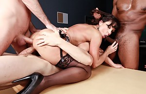 It's not the best case scenario for her, but she seems to enjoy getting ruthlessly banged by three massive, meaty cocks at the same time.