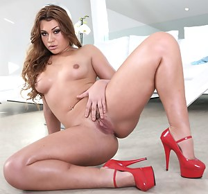 Slutty redhead model wearing red shoes is deepthroating her strong partner's big dick before getting her wide ass penetrated wildly.