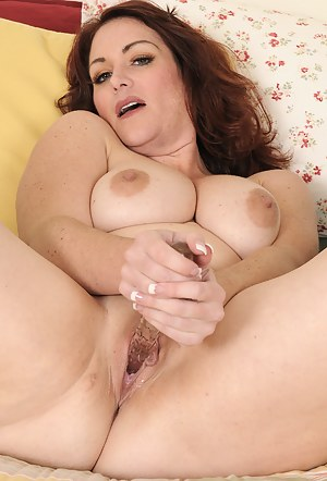 Busty 35 year old Ryan from AllOver30 enjoying her long glass dildo