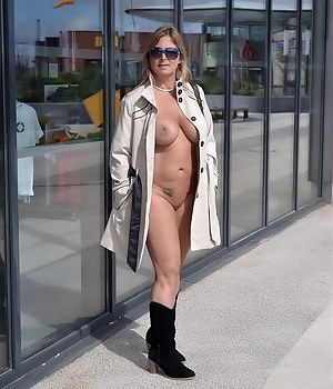 I just wanted look at any shop windows, so I've just thrown over the coat when I went out from the naturist complex. Tha