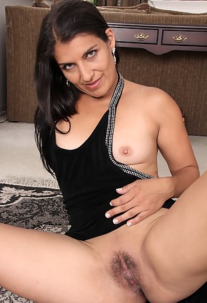Stunning brunette housewife Saffron LeBlanc getting naked in here