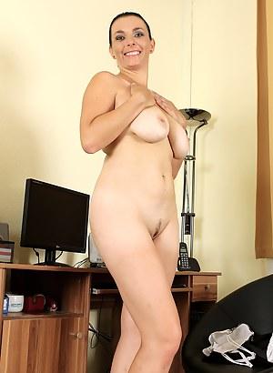 Hot brunette secretary Leona Sweet unleashes her massive mams