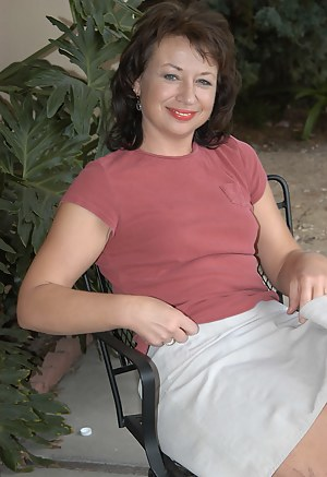 Alannah strips and spreads her pussy outside on the patio