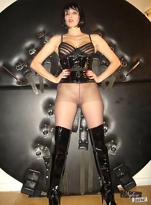 Jane sits in her dungeon wearing nylon pantyhose