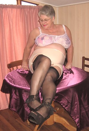 This Mauve Mama has it all for you to pleasure your cock. Sexy black seamed stockings, girdle and pretty bra, the perfec