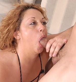 Big titted mature slut sucking a hard throbbing cock