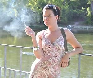 Brunette babe smoking at the riverside