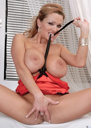 Sexy and alluring milf Sharon Pink shows off her tight Anilos ass and fingers her pink juice box