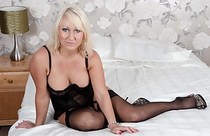 Hot blonde milf playing on her bed