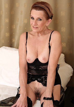 Mature housewife Lucy O peels her 58 year old pussy lips apart