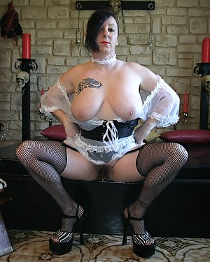 Dressed as a French maid I show my hairy pussy