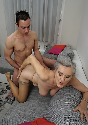 Horny mature lady playing with her toy boy