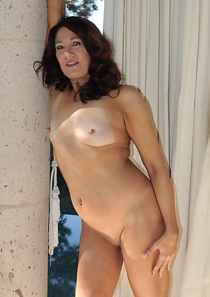 52 year old Renee Black spreading her legs on the backyard deck