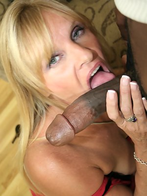 Horny housewife munching on a big black cock