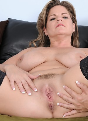 37 year old Marie Micheals strips off lingerie and tugs on pussy hair