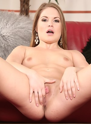 Alessandra Jane stuffs glass toy deep in her pussy.