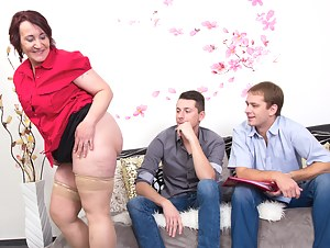 Two guys sharing a naughty mature lady