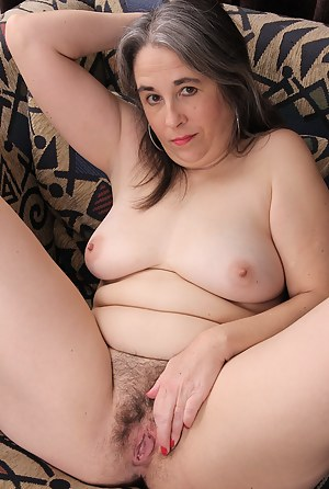 Olivia Olay slips out of her sheer lingerie to show her hairy pussy