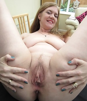 I love being naked and on camera. In this set, you can get up close and personal with my MILF pussy